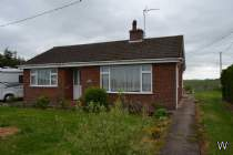 Main Photo of a 2 bedroom  Detached Bungalow for sale